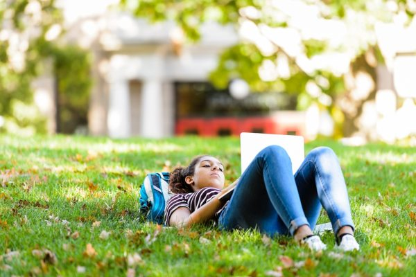 Student studying in the grass at Bascom Hill.
