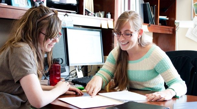 Financial aid administrator talking to a student.