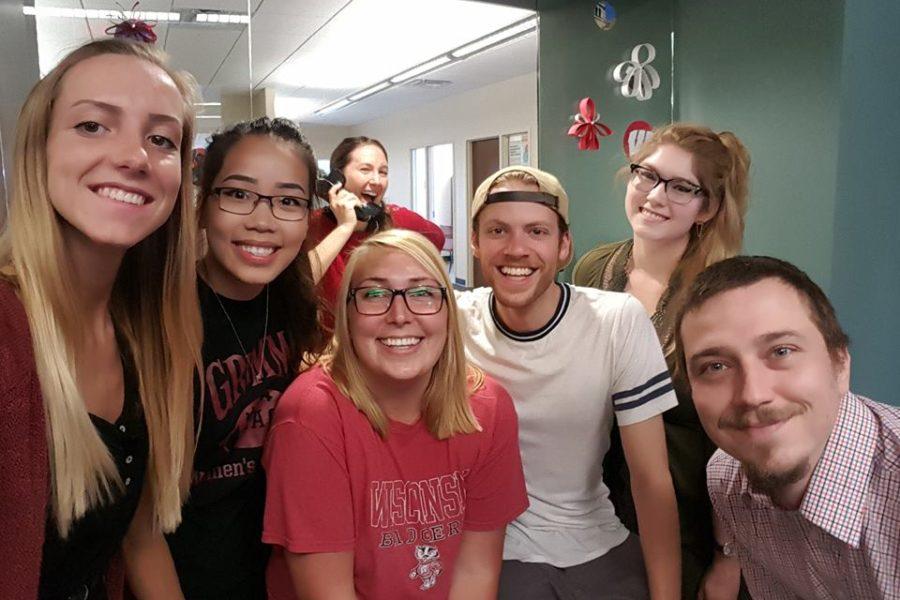 Front Desk Team posing for National Selfie Day